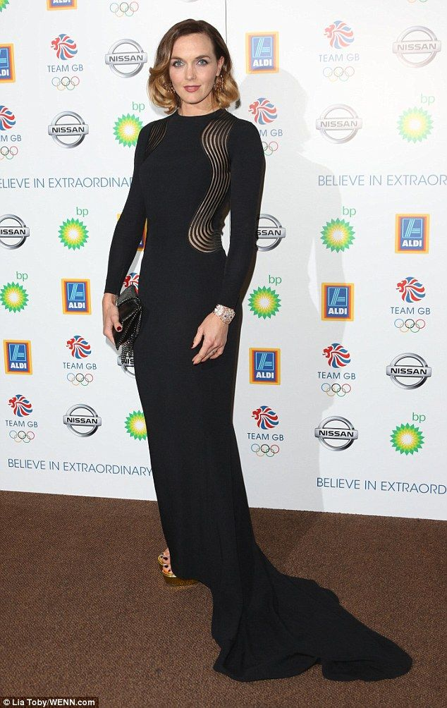Glamour: Victoria Pendleton looked impeccible in a floor-length black gown as she arrived on the red carpet at the Team GB Olympic Ball at the Royal Opera House in London on Wednesday