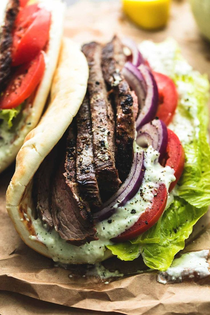 Easy and flavorful flank steak gyros with tzatziki cucumber sauce, made with a simple marinade for the beef, and creamy Greek tzatziki sauce in a soft pita.