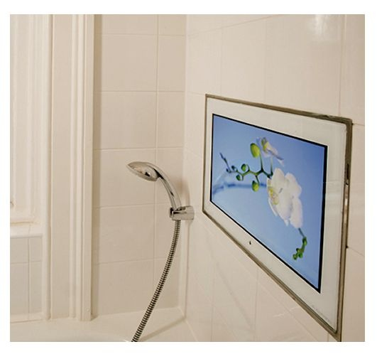 "Aquavision 26"" Framed Waterproof LED TV. Shown above a bath, built into the wall. Bathroom TVs from UK Bathrooms"