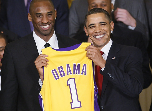 President Barack Obama, standing with Los Angeles Lakers guard Kobe Bryant