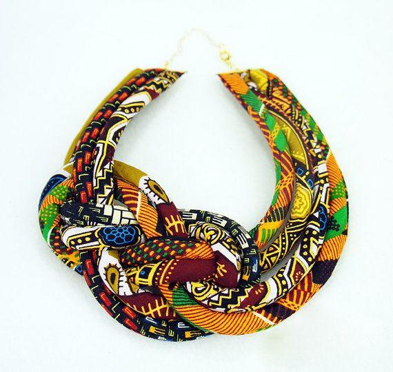 This beautiful multicolored African print necklace goes well with the clutches sold in the Zipped & Printed etsy shop. It, like they, is made by hand with authentic African wax prints and can be worn any season!