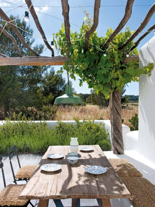 It is freezing in California. I'm not complaining, especially after it was starting to feel like Indian summer had overstayed it's welcome. But I can't help but swoon over this breathtaking estate in Ibiza. The white washed walls, exposed wood beams, cement poured floors and thatched outdoor
