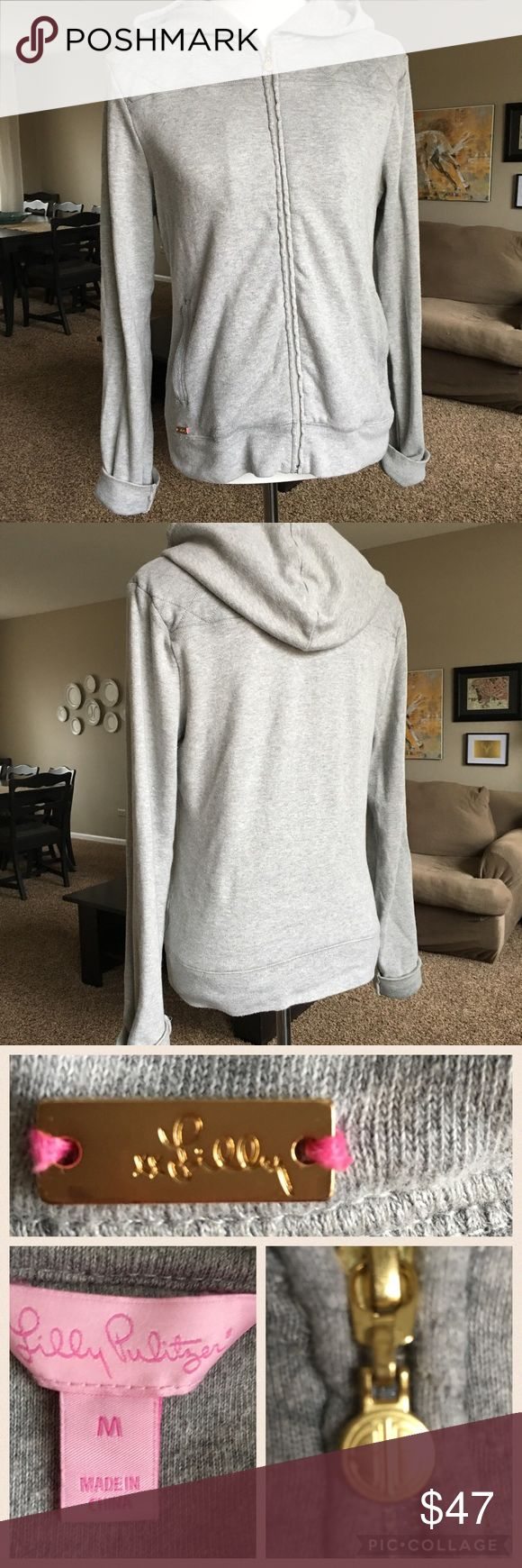 "Lilly Pulitzer Grey Zip Up Sweatshirt w/Hood Sz. M Hard to find LILLY PULTIZER grey hoody zip up sweatshirt.  Quilted shoulder detailing.  Super soft and high quality 100% cotton.  In great condition with a minor flaw *see last pic tiny stain on sleeve near elbow*   Armpit - Armpit approx  21.5"" Length 24""     No trades.  Offers welcomed. Lilly Pulitzer Tops Sweatshirts & Hoodies"