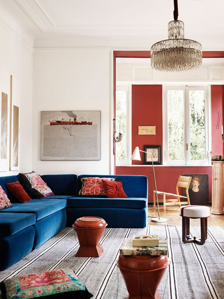 modern blue velvet sofa with red accents