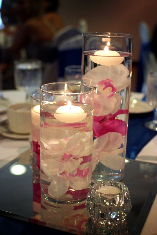 DIY centerpiece-white and fushia silk submerged orchids with a floating candle