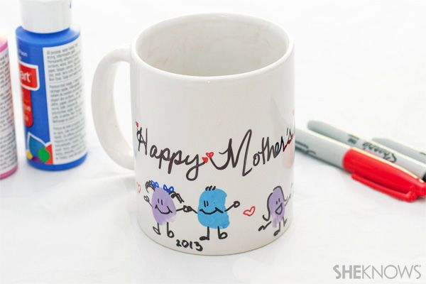 Mother's Day thumbprint tea mug  Give mom something crafty to wake up to on Mother's Day with these homemade mugs kids can make!  #Homemade #Mothersday #crafts  @SheKnows