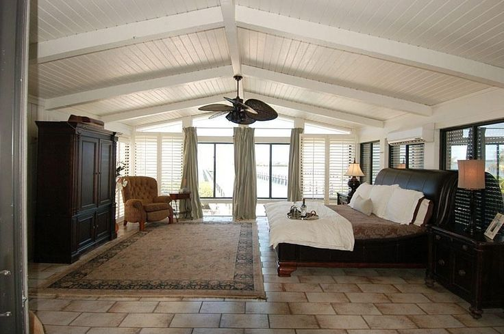 Tropical Master Bedroom with Slim chadwick media armoire, Ellsworth leather sleigh bed without footboard, Exposed beam