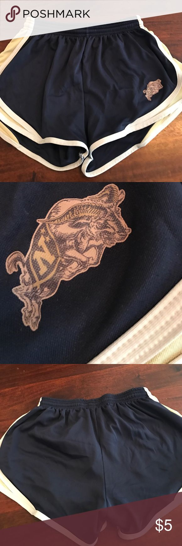 USNA Navy athletic shorts unlined size large This is a pair of navy blue nylon athletic shorts with gold and white trim. It has the US Naval Academy goat logo on the bottom. They have an elastic waist with a drawstring and are size large ladies fit 2 win Shorts