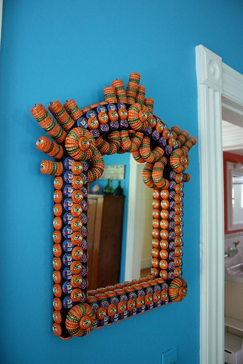 """Sneak Peek: A Massachusetts Farmhouse Where Color and Pattern Meet. """"This folk art orange mirror made from recycled bottle caps is a bright complement to our blue den walls which are Yosemite Blue by Benjamin Moore."""" #sneakpeek"""