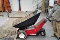 Wheelbarrowing concrete - the easy way! So easy to fil up the Electric Wheelbarrow direct from the concrete lorry and then deliver it to exactly where you want it. Holds about the same amount of concrete as 3 ordinary wheelbarrows.