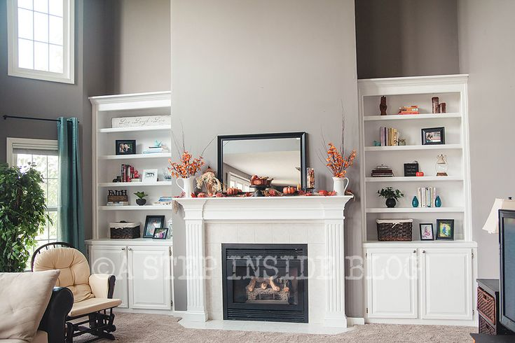 Would love this fireplace mantel and cabinet shelves in for Bookshelves next to fireplace