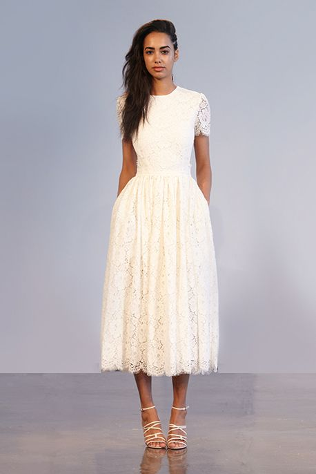 PRINCE: Short Sleeved Guipure Lace Dress With Full Skirt & Open Back & Scalloped Edge Detail from Houghton NYC.