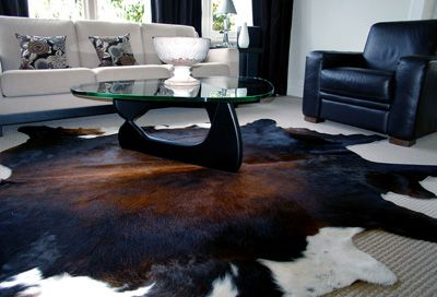 Cow Hide Rug... perfect for underneath my leather couch or in my home library!