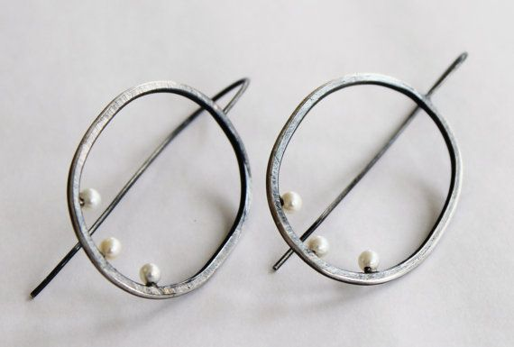 LOVE the juxtaposition of the elegant pearls against the rough, oxidized silver of these earrings.