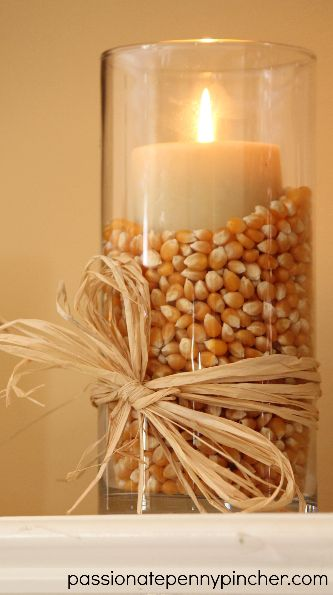 I love popcorn....I could do this with those candle sticks that have a liner between the candle & the outside...or use that round centerpiece bowl....upside down with the inner circle filled with acorns etc.: