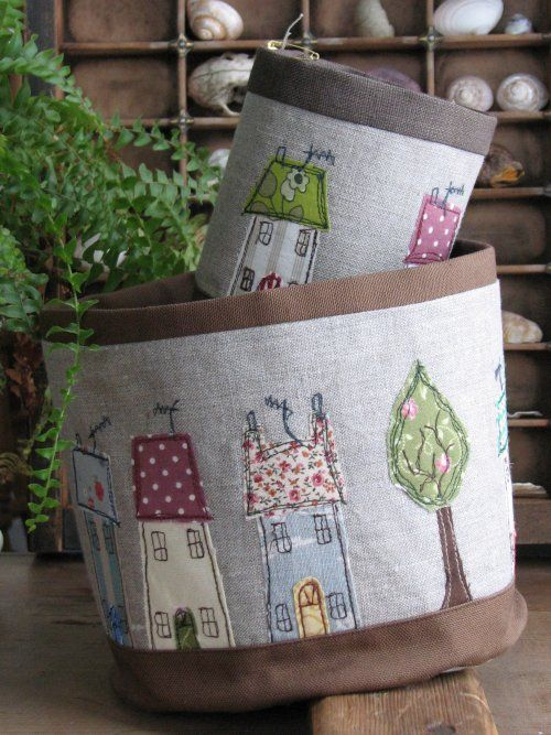 fabric baskets wit appliqued houses