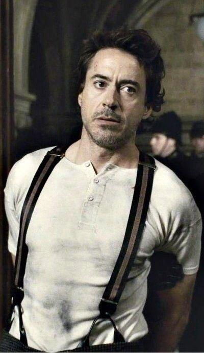 Robert Downey Jr. as Sherlock Holmes in Sherlock Holmes (2009)/Sherlock Holmes: A Game of Shadows (2011)