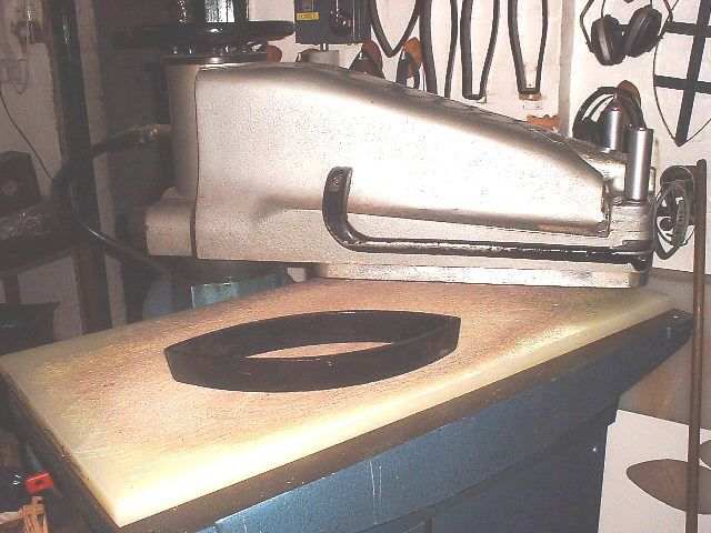 Rugby Football History - Press and Knife Layers of cotton and polyester material are bonded together using glue. This is then covered with a layer of rubber to produce the laminate sheets that the ball panels are cut from. The sheets are printed with the desired panel design and then cut into panel shapes using a knife. The knife is a specially designed metal tool used to cut the exact shape of each panel. The cutting process uses a hydraulic press and templates to ensure accuracy