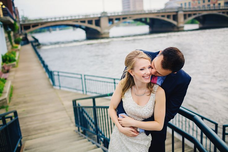 Downtown Grand Rapids Skyline, urban photography, Michigan photography, engagement photography, bridge, Gran River, engagement photography, unique engagement portrait