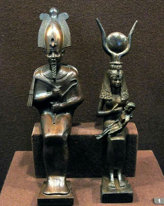 "Statue of AUSAR (""Osiris"") and AUSET (""Isis"") who is nursing HERU (""Horus""). The original ""Holy Trinity""."