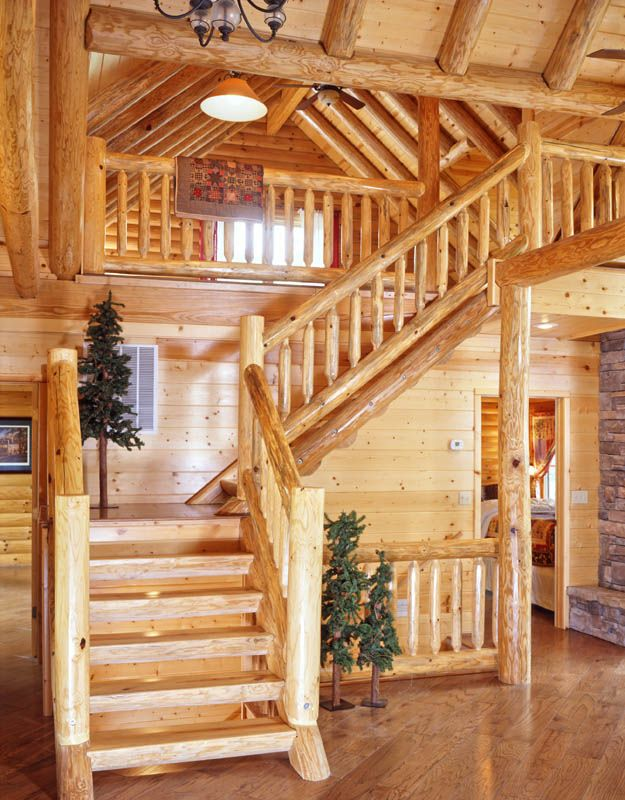 open staircase with wood treads and risers | Shaped log home staircase has a more rustic feel with the treads ...