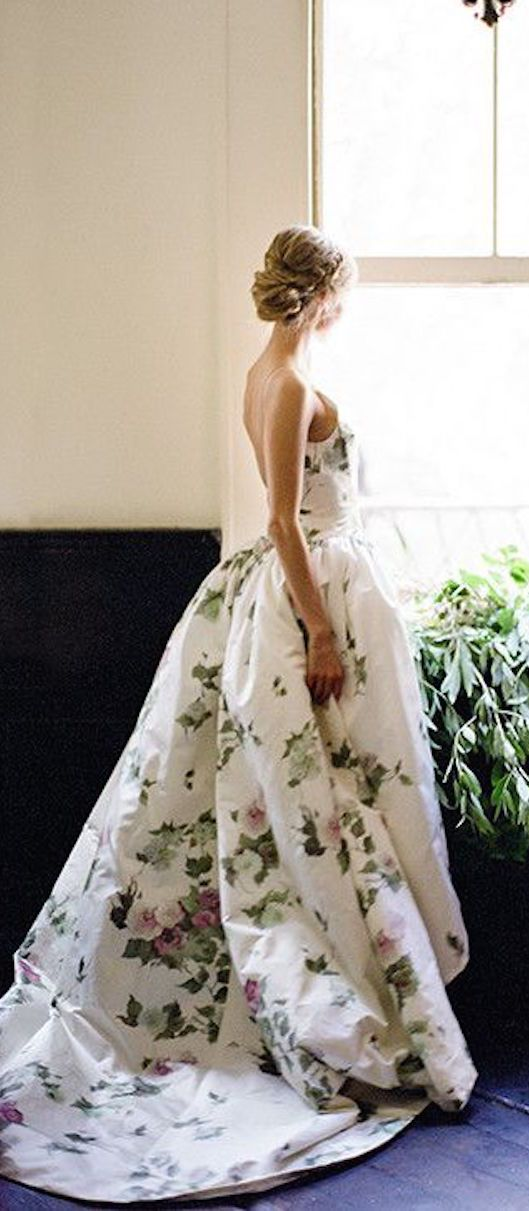 Elizabeth Filmore gown looking elegant, if a bit like a comforter. The model's hair is all elegance