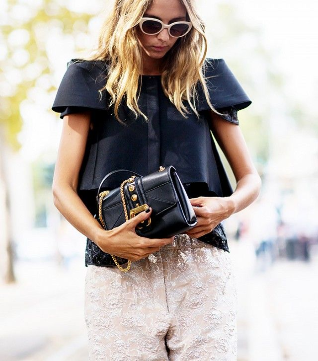 The Latest Street Style Photos From Milan Fashion Week via @WhoWhatWear--- structured shoulders