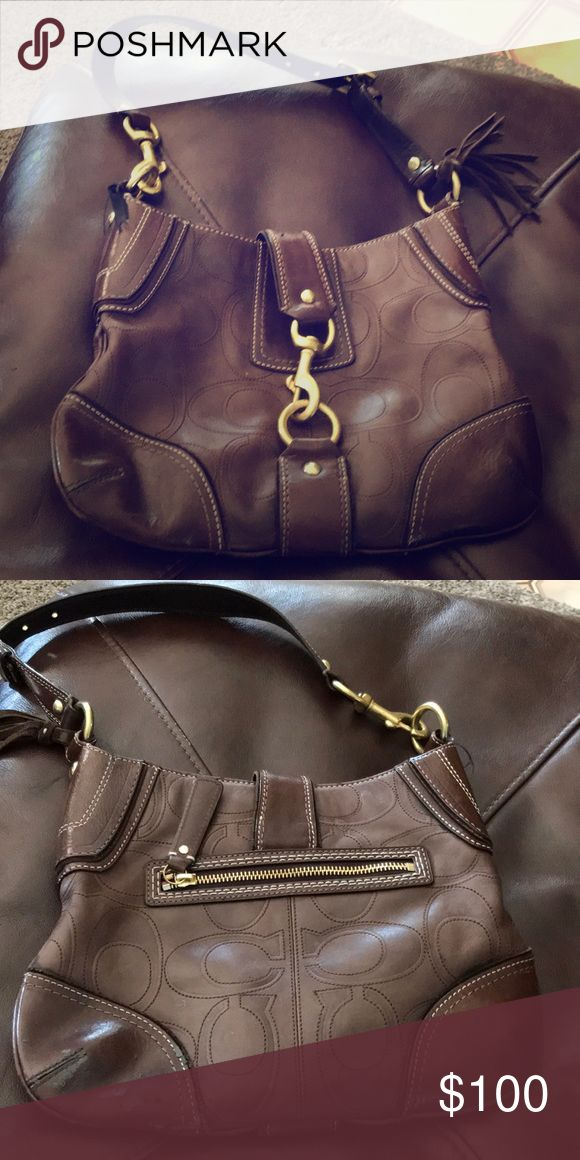 Coach shoulder bag w buckle closure In used condition some of the leather on the bottom is a little beat up from normal usage this was one of my favorites! Big zipper space on opposite side and plenty room inside Coach Bags Shoulder Bags
