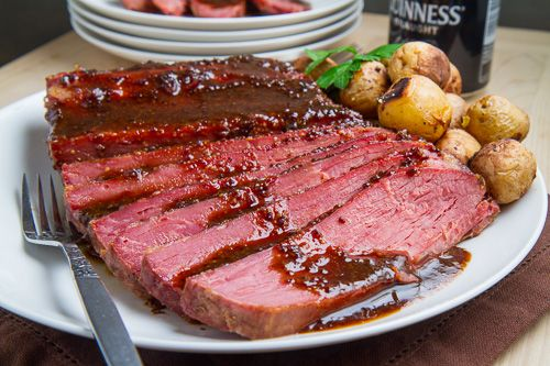 Guinness Glazed Slow Cooker Corned Beef- The Glaze is made from the cooked juices, brown sugar, & Worcestershire, cooked & reduced in a pan til caramelized... yum. I gotta try this.