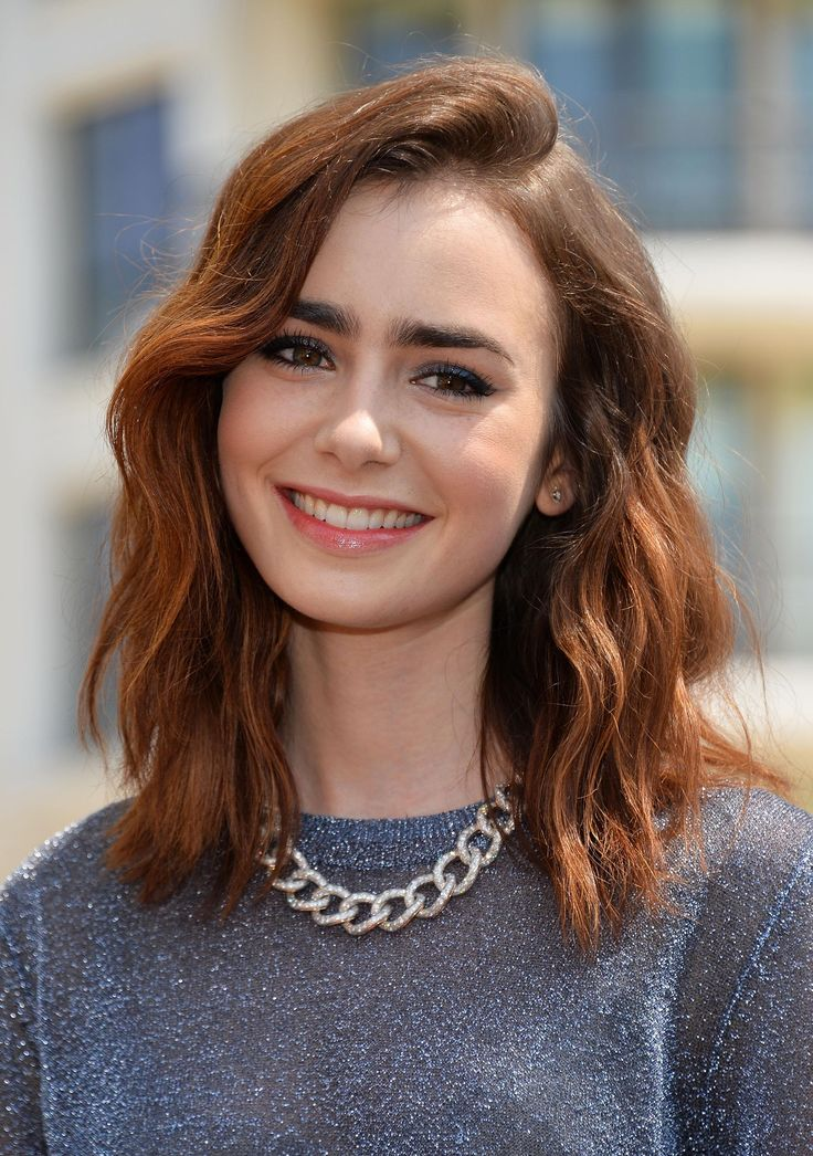 Here's proof that Lily Collins can rock every single hairstyle...auburn and wavy