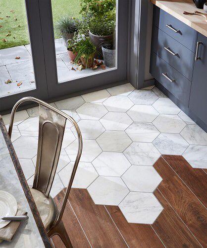 Hexagonal marble tiles meet floorboards - topps tiles
