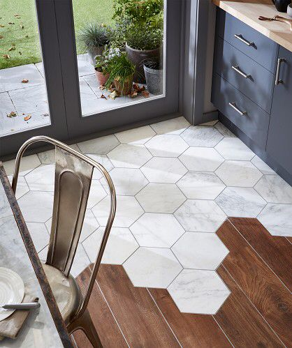 Hexagonal marble tiles meet floorboards - topps tiles