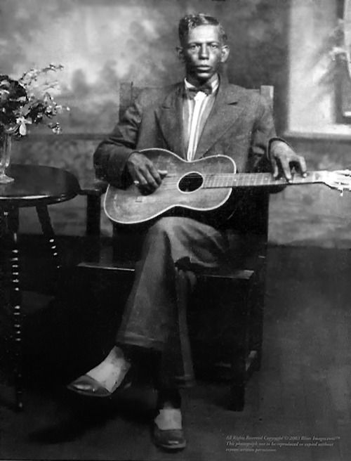 "Charley Patton (1887/1891? – 1934: only known photograph; 1929). He is considered by many to be the ""Father of the Delta Blues"", and created an enduring body of American music which inspired nearly every Delta blues artist who followed him. Considered among the most important roots musicians that America produced in the 20th century, Patton's gritty bellowing was a major influence on the singing style of his young friend Chester A. Burnett, who went on to gain fame in Chicago as Howlin'…"