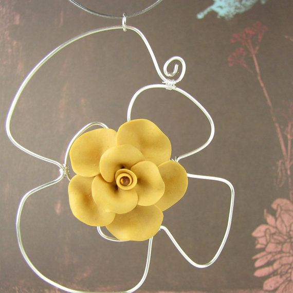Polymer clay yellow blossom necklace, Etsy listing at https://www.etsy.com/listing/234485866/pendant-on-wire-necklace-yellow-rose