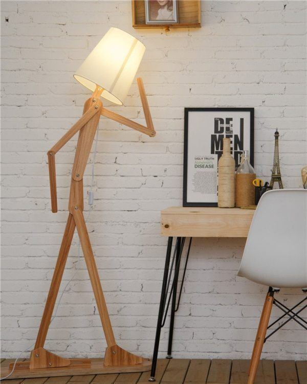 Funny Stick Figure Floor Lamp: This creative DIY floor lamp requires some assembly, a fun challenge for anyone who likes to get hands-on with their home decor. You can even pose the stick figure however you want! Get creative! The wood elements are available in teak, butternut, ash, or walnut.