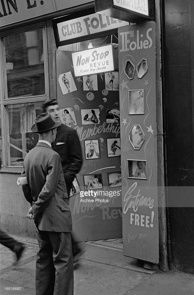 Men at the entrance to a strip club in Soho, London, April 1961.