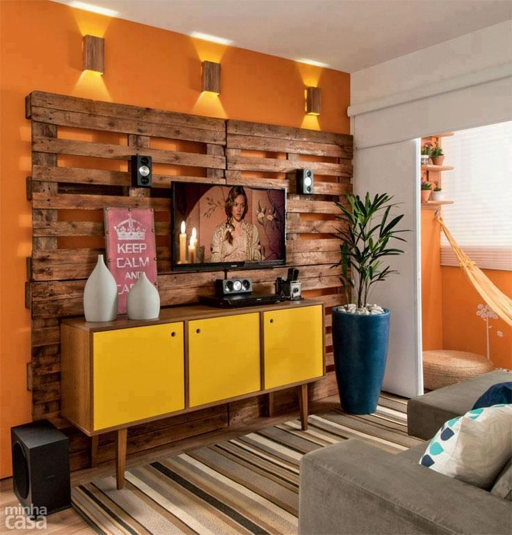 Loving this palette-backed entertainment wall! Stain the palettes, and attach to your wall with sturdy anchors (and perhaps some 3M strips), then add a vintage (or vintage-y Ikea piece) out front to house your TV and components. Talk about a one-of-a-kind conversation piece!