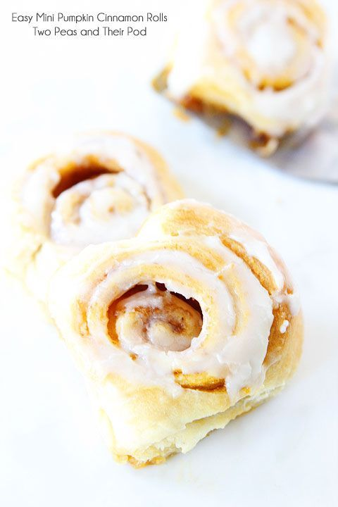 Easy Mini Pumpkin Cinnamon Rolls Recipe on twopeasandtheirpod.com These cinnamon rolls take less than 30 minutes to make!