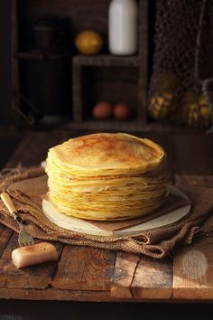 Lemon and Anise Crepes! (page is in Spanish) Translated: 5 medium eggs 1/2L whole milk 60g butter, melted 75ml water The zest of one lemon Pinch of salt 50g icing sugar 200g flour A gush of anise (To taste) In addition: A piece of bacon Cinnamon sugar (for sprinkling)