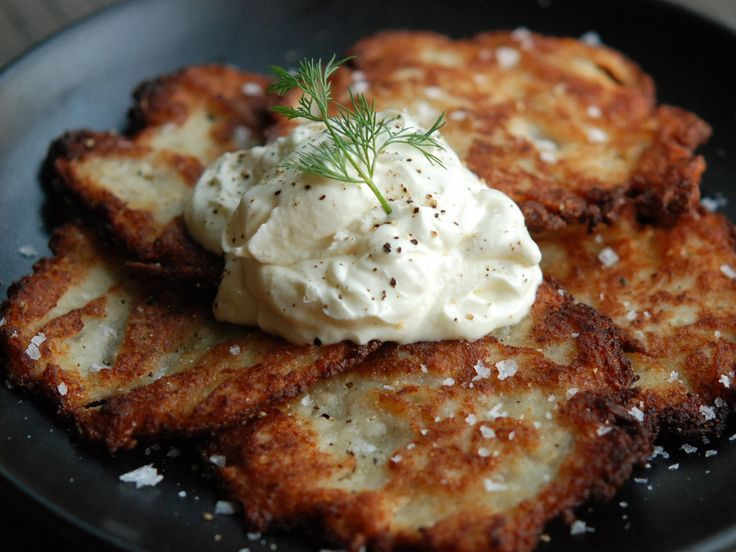 Andrew Zimmern makes his latkes with both boiled and grated raw potatoes to add both creaminess and crispiness.