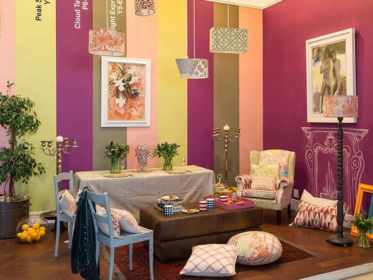Plascon Spaces Showroom   The stripes create dimension and balance out the dramatic purple feature wall.
