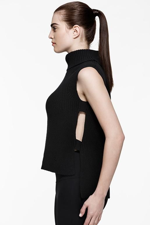 With a sleek open side design, this sleeveless silhouette works both as a layering piece or on its own.  Made from a wool blend knit that's both durable and warm, while remaining breathable.         Stylist's Notes: Pair with our Diva Vegan Leather Leggings for a versatile look that works for day or night.