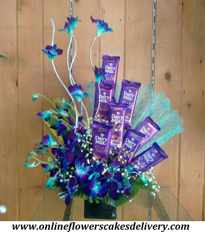 Chocolate Bouquet Online: Buy & Send Chocolates Bouquet online to Delhi, Mumbai, Bangalore & other cities in India & worldwide with Express Delivery in India. Online flowers cakes delivery in India. #Chocolatesbouquet #Dairymilkchcolate  #Freshorchid #Orchidflowers #Blueorchid #Indiaflorist #Onlineflorist URL :- www.onlineflowerscakesdelivery.com