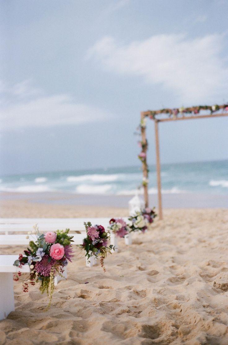 beach wedding ceremony on the sand with a simple arch. If you want the best…