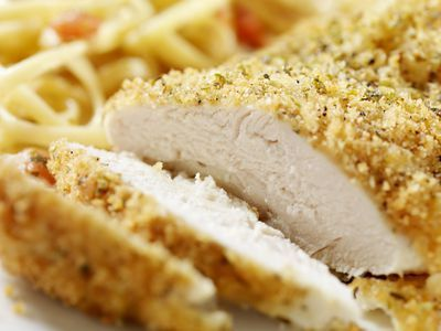 These baked Boursin chicken breasts are stuffed with Boursin cheese and vegetables and then they are coated with bread crumbs and Parmesan cheese.