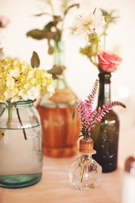 love the different bottles and wild flowers