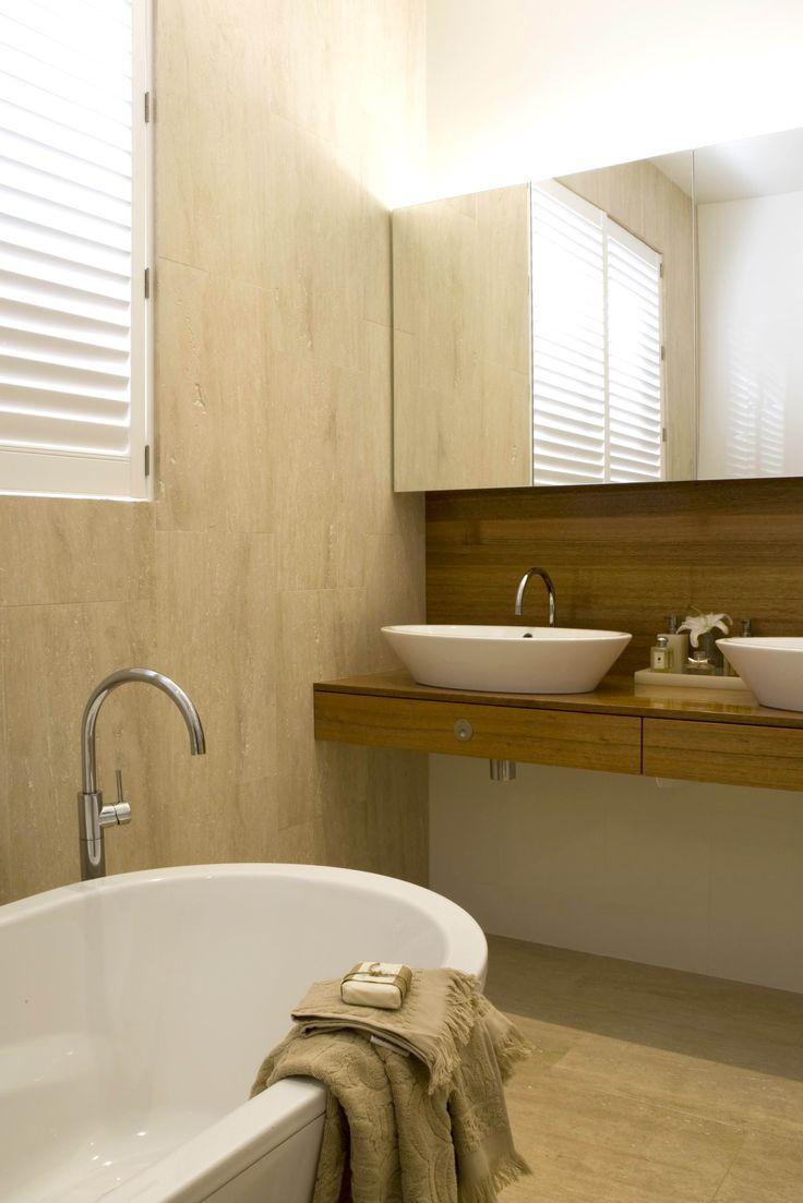 Seaside Bathroom with timber drawer benchtop and splashback. Brooke Aitken Design