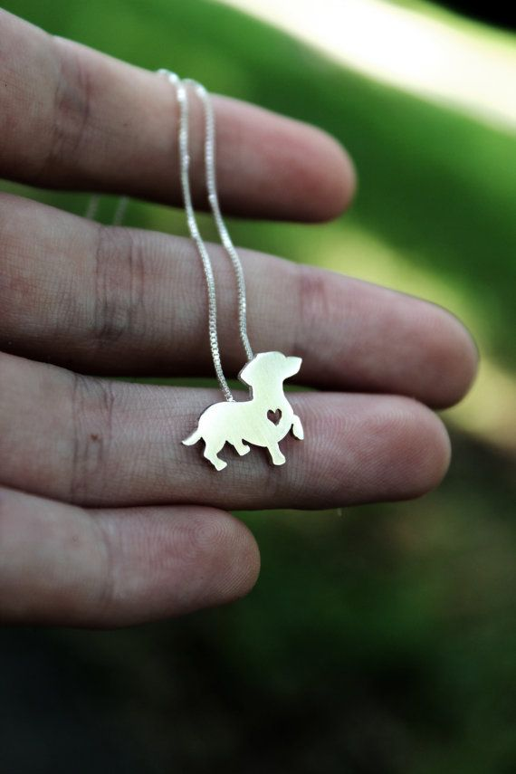 "This tiny Dachshund necklace is a perfectly delicate way to keep a loved pet close to your heart. Just ⅝"" at its largest dimension, our pendants"