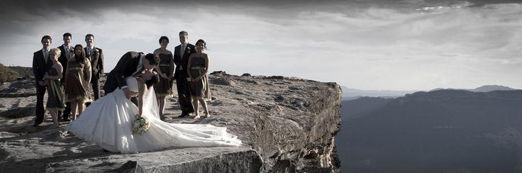 Wedding party on cliffs edge blue mountains. Photographer Eddie Misic