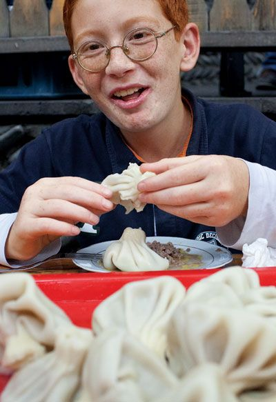 A specialty of dumpling houses in Tbilisi, Republic of Georgia, these large, juicy pork-and-beef-filled pockets are spiced with chiles, cilantro, and fenugreek.